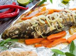 Как запекать рыбу в фольге в духовке